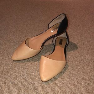 Halogen nude and black pointed toe flats